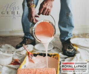 man pouring pink paint in paint tray