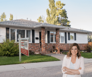 Image of Alyss standing in front of a house for sale.